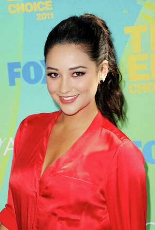 Actress Shay Mitchell arrives at the 2011 Teen Choice Awards held at the Gibson Amphitheatre in Universal City, California. Photo: Jason Merritt, Getty Images / 2011 Getty Images