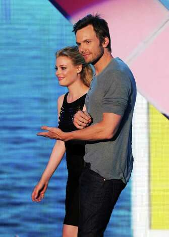 Actors Gillian Jacobs (L) and Joel McHale onstage during the 2011 Teen Choice Awards held at the Gibson Amphitheatre in Universal City, California. Photo: Kevin Winter, Getty Images / 2011 Getty Images