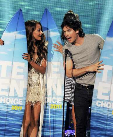 Actors Kat Graham (L) and Ian Somerhalder onstage during the 2011 Teen Choice Awards held at the Gibson Amphitheatre in Universal City, California. Photo: Kevin Winter, Getty Images / 2011 Getty Images