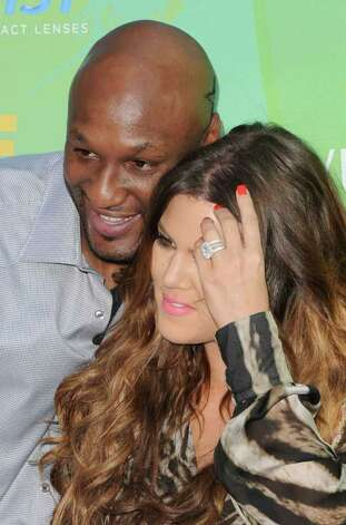 Athlete Lamar Odom and TV personality Khloe Kardashian arrive at the 2011 Teen Choice Awards held at the Gibson Amphitheatre in Universal City, California. Photo: Jason Merritt, Getty Images / 2011 Getty Images