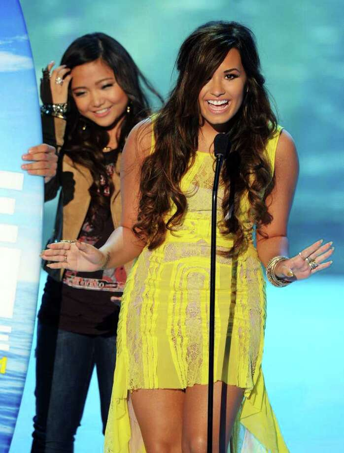 UNIVERSAL CITY, CA - AUGUST 07:  Charice (L) and Demi Lovato onstage during the 2011 Teen Choice Awards held at the Gibson Amphitheatre on August 7, 2011 in Universal City, California. Photo: Kevin Winter, Getty Images / 2011 Getty Images