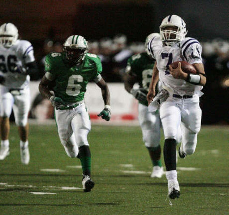 Dayton quarterback Cody Green rushes for a 70-yard gain as he breaks away from Brenham's Trenton Thomas. Photo: Bob Levey, For The Chronicle