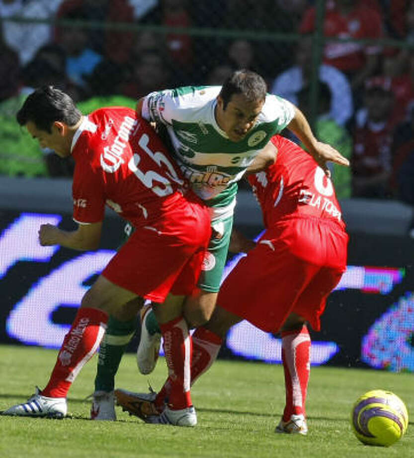 Israel Lopez, left, Manuel de la Torre, right, and Toluca denied Cuauhtémoc Blanco and Santos in the Mexican playoffs. Photo: Gregory Bull, AP