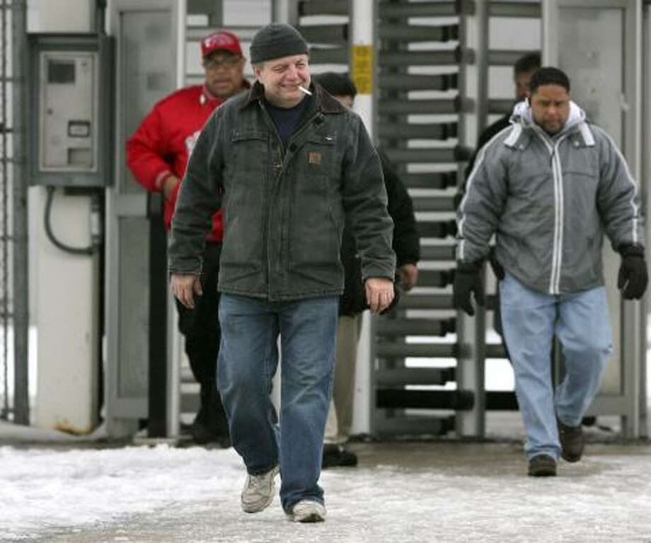 Workers leave a Chrysler Jeep plant in Toledo, Ohio, after their shift Friday. The auto industry took home an early holiday gift Friday with President George W. Bush's offer of $17.4 billion in emergency loans. Photo: MADALYN RUGGIERO, ASSOCIATED PRESS