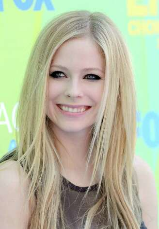 Musician Avril Lavigne arrives at the 2011 Teen Choice Awards held at the Gibson Amphitheatre in Universal City, California. Photo: Jason Merritt, Getty Images / 2011 Getty Images