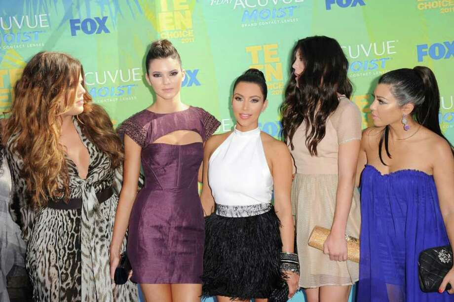 UNIVERSAL CITY, CA - AUGUST 07:  (L-R) TV personalities Khloe Kardashian, Kendall Jenner, Kim Kardashian, Kylie Jenner and Kourtney Kardashian arrives at the 2011 Teen Choice Awards held at the Gibson Amphitheatre on August 7, 2011 in Universal City, California. Photo: Jason Merritt, Getty Images / 2011 Getty Images