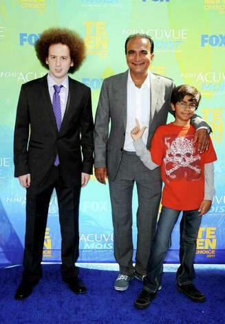 Josh Sussman, Iqbal Theba, and guest arrive at the 2011 Teen Choice Awards held at the Gibson Amphitheatre in Universal City, California. Photo: Jason Merritt, Getty Images / 2011 Getty Images