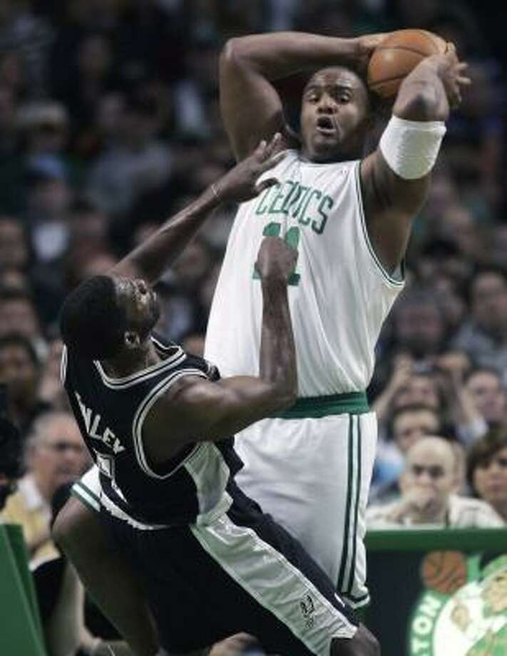 The Celtics' Glen Davis was a tower of power to Michael Finley and other Spurs on Sunday. Photo: MICHAEL DWYER, ASSOCIATED PRESS