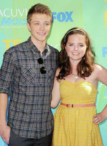 Actor Sterling Knight (L) and guest arrive at the 2011 Teen Choice Awards held at the Gibson Amphitheatre in Universal City, California. Photo: Jason Merritt, Getty Images / 2011 Getty Images
