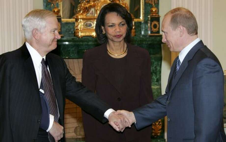 "U.S. Defense Secretary Robert Gates, left, praised the ""positive tone"" of the meeting that he and Secretary of State Condoleezza Rice had Monday with Russian President Vladimir Putin, right, at the Kremlin. Photo: VLADIMIR RODIONOV, ASSOCIATED PRESS"