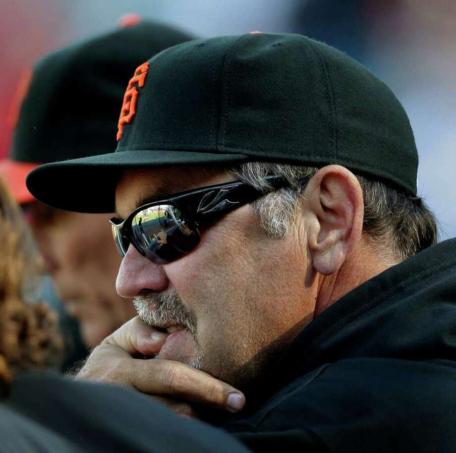 This photo made Aug. 5, 2011, shows San Francisco Giants manager Bruce Bochy biting his fingernail prior to a baseball game against the Philadelphia Phillies,  in San Francisco. Bochy hasn't touched chewing tobacco since April 14, the night before seeing hypnotherapist Dr. AlVera Paxson during his team's first road trip to Arizona. (AP Photo/Ben Margot) Photo: Ben Margot, STF / AP