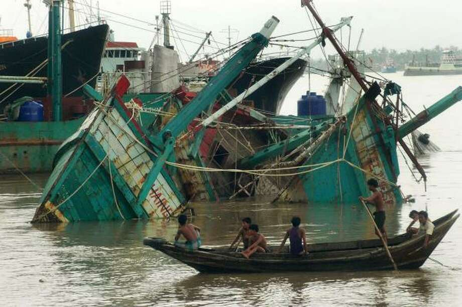 Fishing boats destroyed by the cyclone float in the port of Yangon in Myanmar on Sunday. Tropical Cyclone Nargis destroyed buildings and roads and cut off communication in the military-run country. Photo: KHIN MAUNG WIA, AFP/GETTY IMAGES