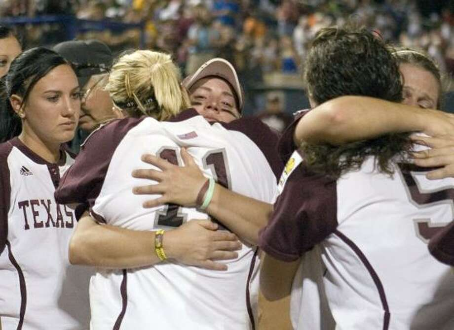 Texas A&M players console each other after losing to Arizona State on Tuesday night. Photo: ALONZO ADAMS, ASSOCIATED PRESS