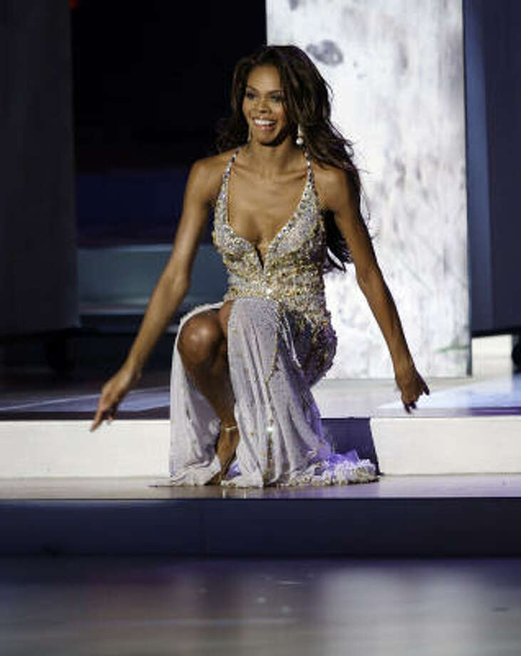 Crystle Stewart, Miss USA, falls down during the evening gown segment of the Miss Universe 2008 beauty pageant in Nha Trang, Vietnam, on Monday. Photo: Vincent Yu, AP
