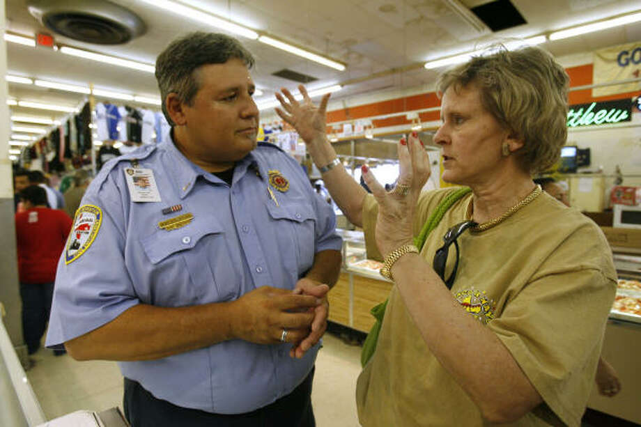 City Council member Toni Lawrence, seen with Houston Fire Department inspector Karl Schafler, initiated the raid at New Flea Market on Sunday. Photo: Nathan Lindstrom, For The Chronicle