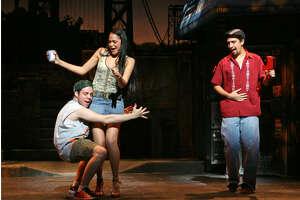 Vanessa (Karen Olivo) works her charms on Sonny (Robin de Jesus) as Usnavi (Miranda) looks on in this scene from In the Heights.