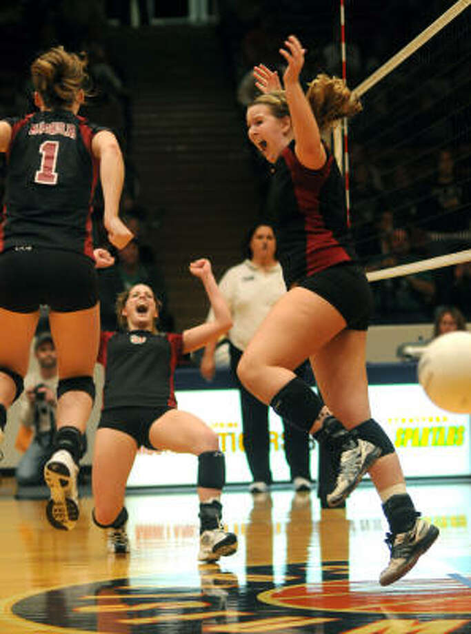 Magnolia senior middle blocker Meagan Little, right, outside hitter Katzy Randall, center, and setter Paige Holland celebrate match point of their regional final win against Brenham on Saturday. Photo: Jerry Baker, For The Chronicle