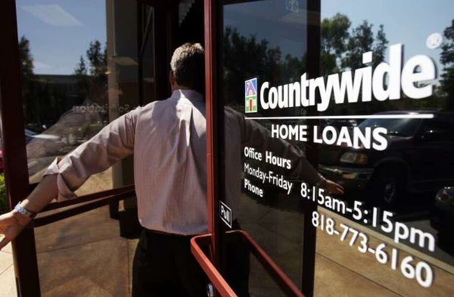 An employee enters a Los Angeles branch of Countrywide Financial Corp. The lender has been buffeted by rumors of bankruptcy and saw its stock tumble as much as 15 percent at one point on Wednesday. Photo: Kevork Djansezian, ASSOCIATED PRESS FILE