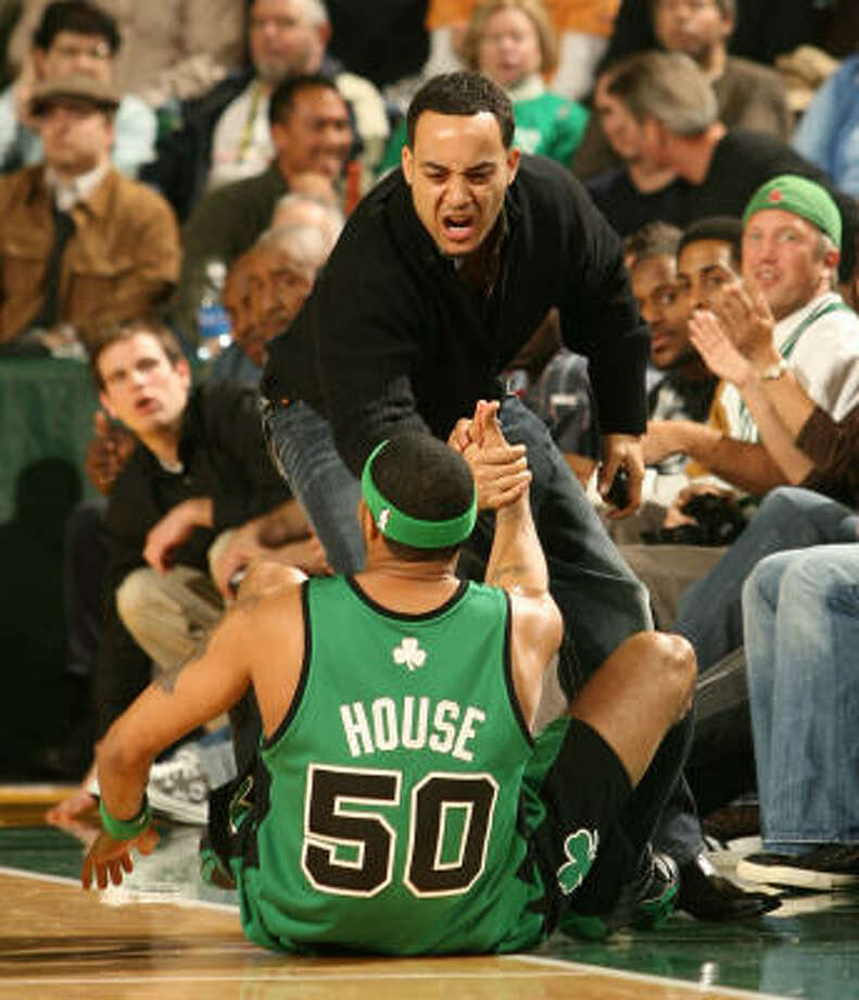 The NBA could use more of this: help from a fan, in this case after a spill by Boston's Eddie House in December. Photo: Otto Greule Jr, Getty Images