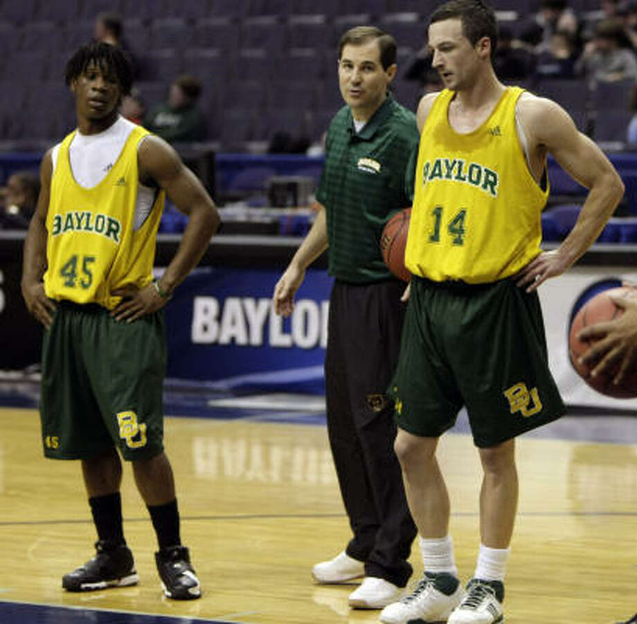 Baylor coach Scott Drew, center, gives instruction to Tweety Carter, left, and Aaron Bruce during the Bears open practice that preceded Thursday's NCAA Tournament matchup with Purdue. Photo: Pablo Martinez Monsivais, AP
