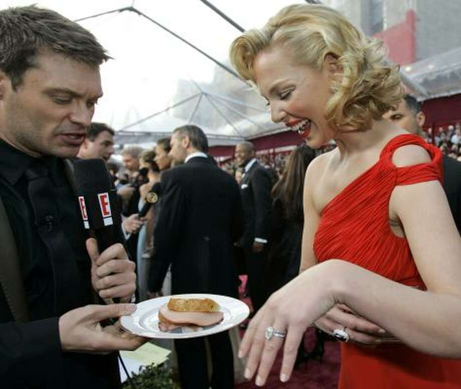 Ryan Seacrest jokes with Katherine Heigl during last month's Academy Awards. Seacrest is seemingly ubiquitous in the entertainment industry with the success of shows like American Idol and his radio program, On Air With Ryan Seacrest. Photo: AMY SANCETTA, ASSOCIATED PRESS
