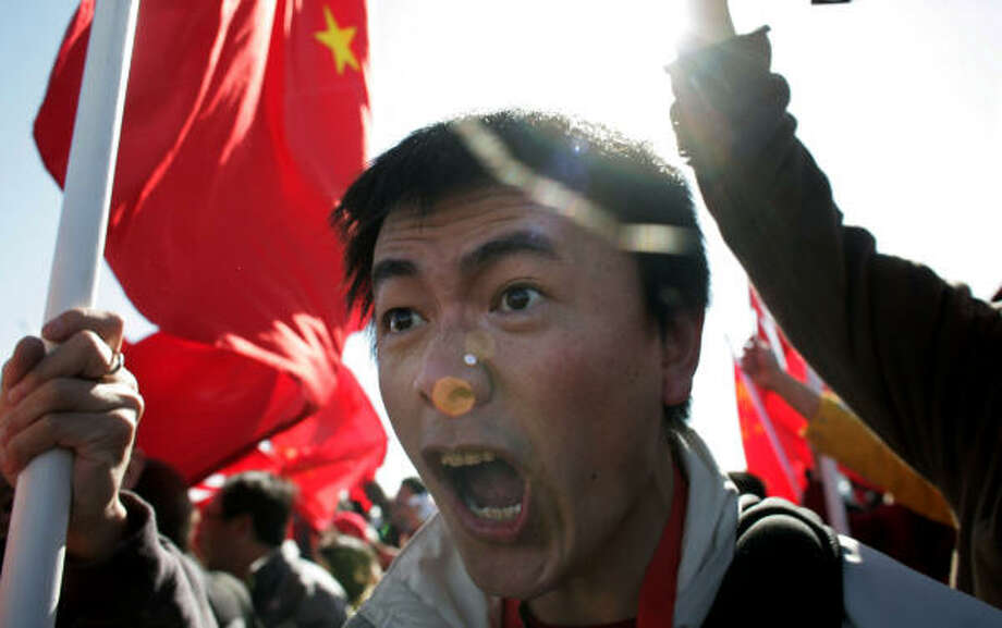 A protester yells at pro-Chinese spectators before the opening ceremonies of the Olympic Torch relay today in San Francisco. Photo: Simon Hayter, Getty Images