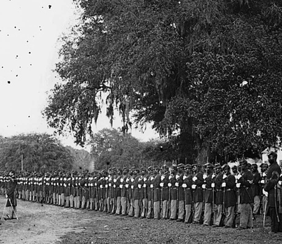 About 1,300 African- and Native American men served in the Union Army during the Civil War as members of the 29th Connecticut Volunteer Infantry Regiment. Some of those soldiers are assembled here in this archival photo. Photo: Library Of Congress / Fairfield Citizen contributed