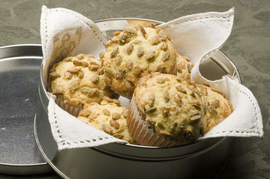 Start your day on the sunny side with Orange Cream Cheese Muffins With Pepita Crunch. Photo: Buster Dean, Chronicle