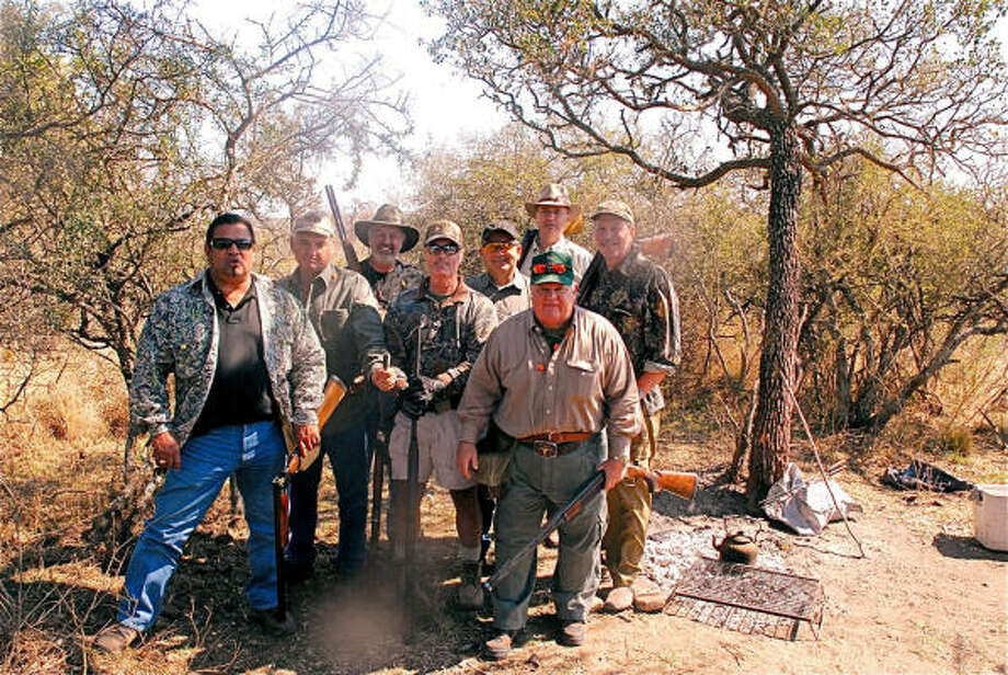 Dove hunting in Argentina was just the ticket for Leo Quintanilla of San Antonio, from left, Danny Janecka, Tom Davis, Tracy Williams, Brian Berger of Schulenberg, Nat Wrontenbery, Tom Pettiette and Dr. Philip Leggett. Photo: Courtesy Photo