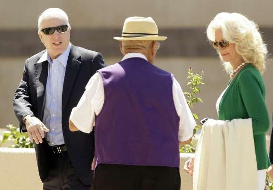 Sen. John McCain, R-Ariz., left, and his wife, Cindy McCain, attend North Phoenix Baptist Church in Phoenix, Ariz. Photo: CAROLYN KASTER, ASSOCIATED PRESS