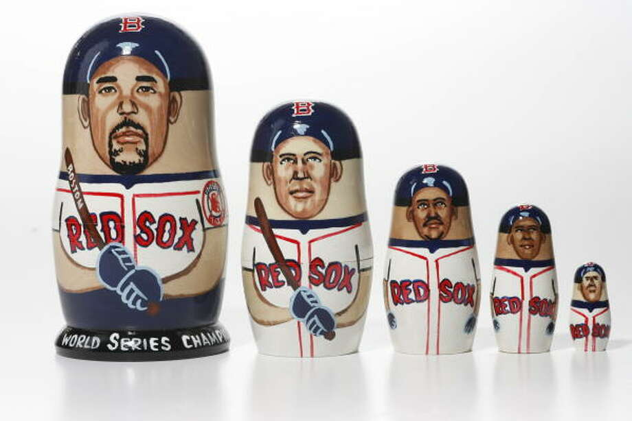 """World Series champions"" nesting dolls include likenesses of Boston Red Sox players, from left, Mike Lowell, Kevin Youkilis, Manny Ramirez, David ""Big Papi"" Ortiz and Dustin Pedroia. Photo: Buster Dean, Chronicle"