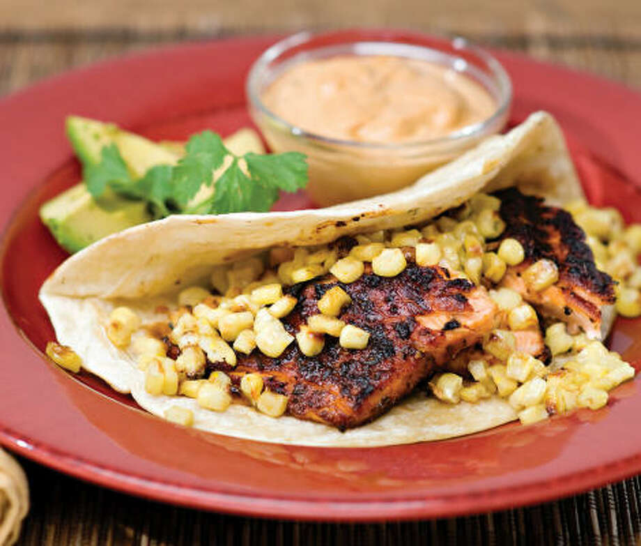 Salmon Tacos With Roasted Corn and Chile Adobo Cream Photo: LORI SANG HSU AND HARLAN CHAPMAN:, WASHINGTON POST