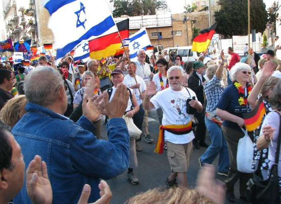 Thousands of Christians from 90 nations marched through Jerusalem on Wednesday as part of the annual Feast of Tabernacles, a biblical pilgrimage festival. Many Israelis turned out to watch the parade. Photo: ROBERT W. GEE, COX NEWS SERVICE