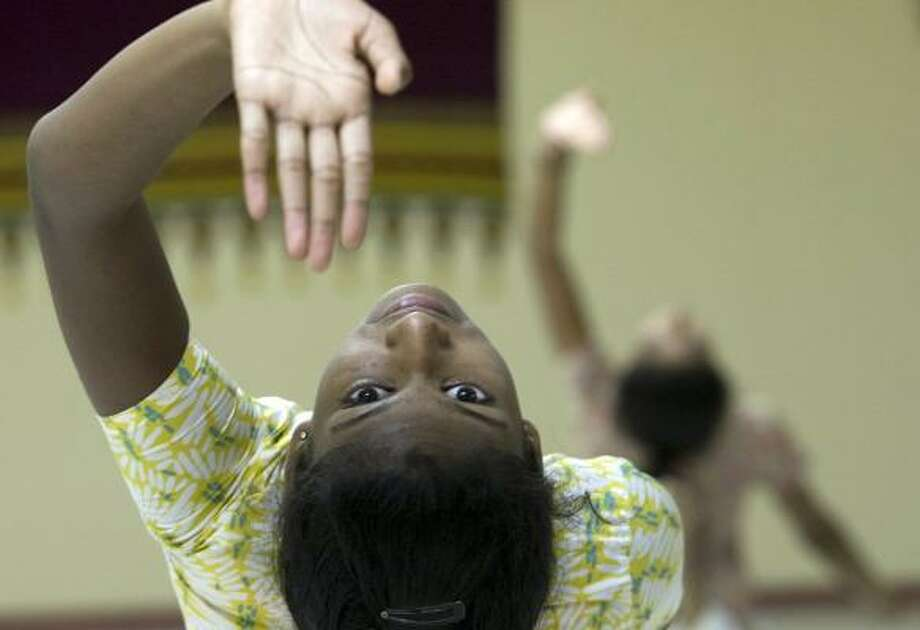 Sindhu Sathees, 11, practices an Indian classical dance at the Anjali Center for Performing Arts. Photo: JOHNNY HANSON, CHRONICLE