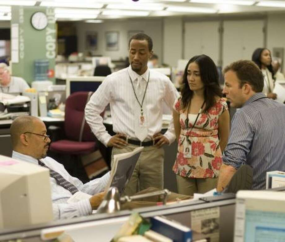 For its fifth and final season, The Wire will go inside the newsroom of the Baltimore Sun. Above, from left, are actors Clark Johnson, Brandon Young, Michelle Paress and Tom McCarthy. Photo: PAUL SCHIRALDI, HBO