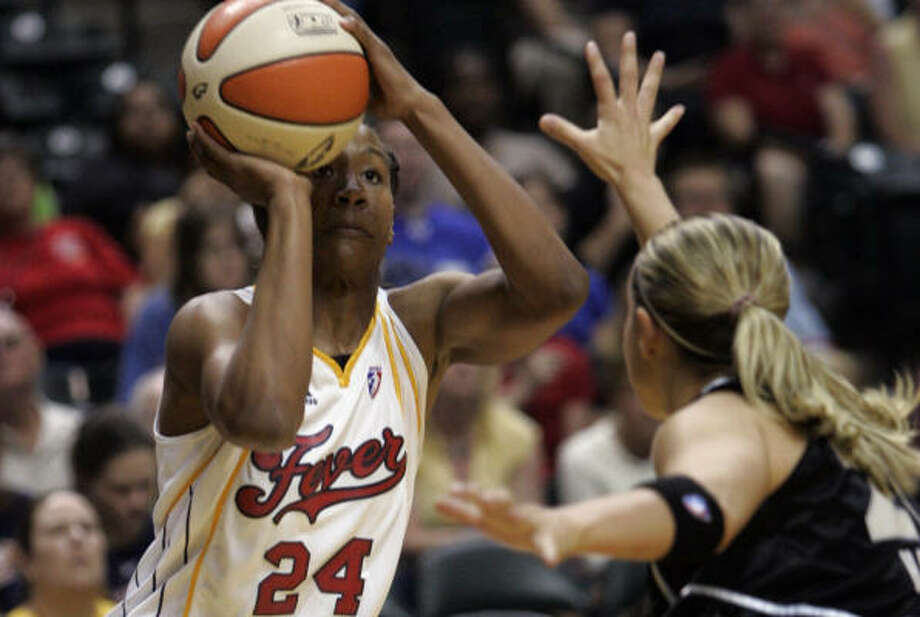 Fever forward Tamika Catchings, left, shoots over the Silver Stars' Becky Hammon in the first half. Photo: AJ Mast, AP