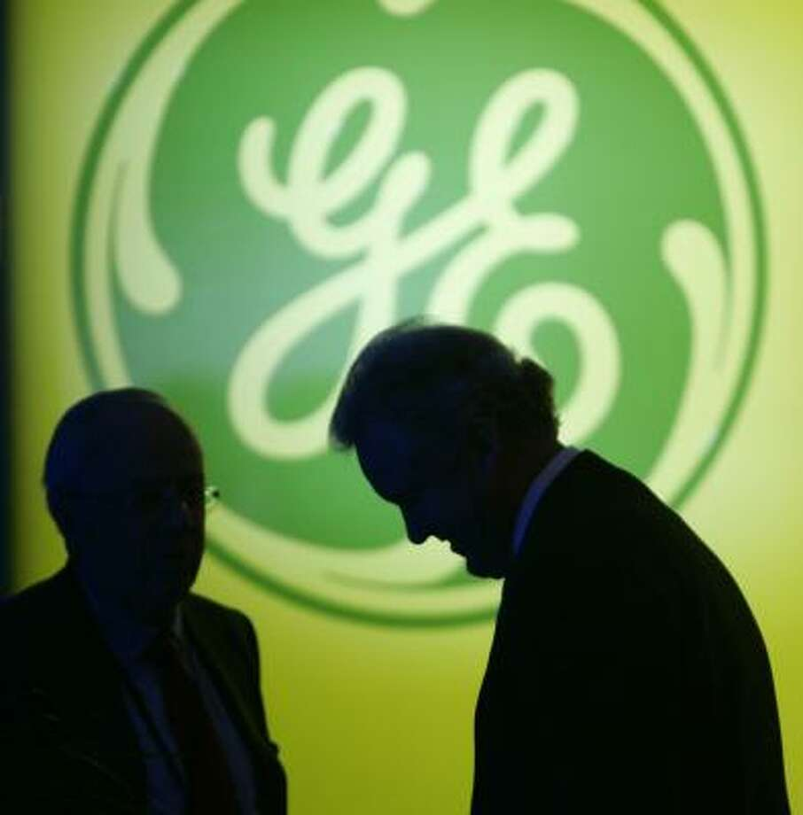 General Electric CEO Jeff Immelt prepares to address shareholders in April. GE blamed volatile financial markets for its lowered earnings forecast for the year. Photo: TONY DEJAK, ASSOCIATED PRESS FILE