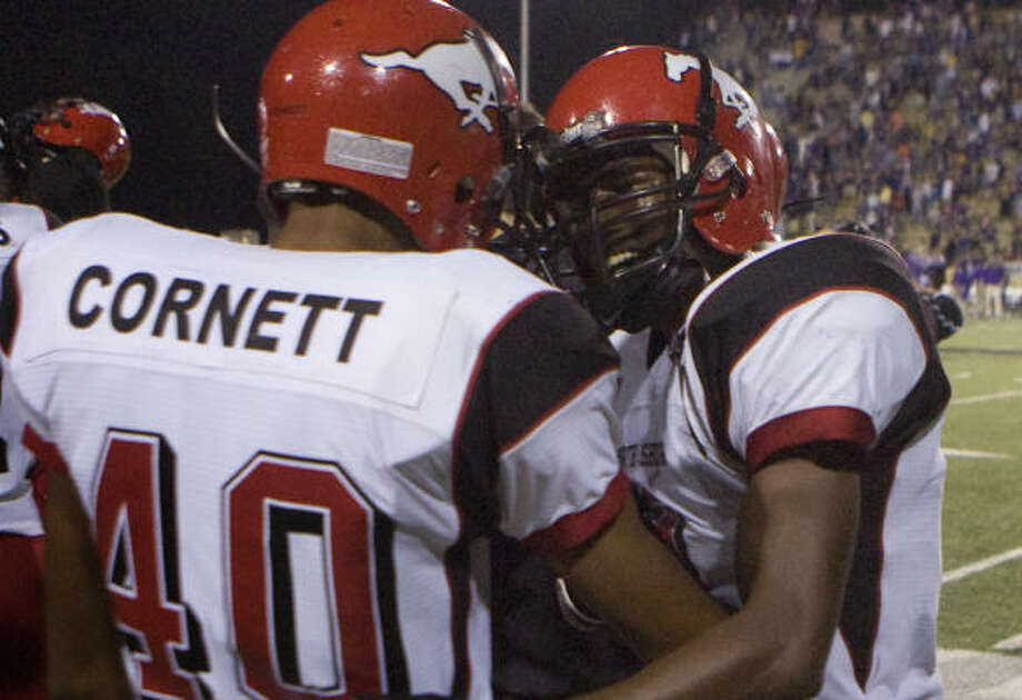 Deandrew White, right, is congratulated by Tim Cornett after scoring the winning touchdown against Lufkin. Photo: Steve Campbell, Chronicle