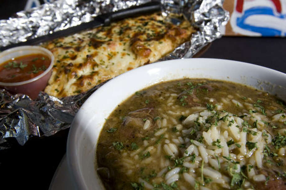 Gumbo with crawfish bread at Beaucoup Wings 'n' Wings restaurant near the University of Houston's main campus off the corner of Elgin and Scott Friday, Oct. 31, 2008, in Houston. Photo: Johnny Hanson, Chronicle