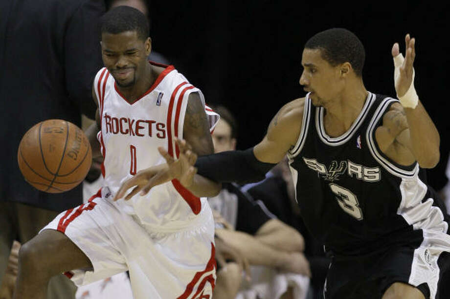 Aaron Brooks gets fouled by Spurs guard George Hill during the second quarter. Brooks was instant offense off the bench in the first half, helping the Rockets  build a 19-point lead at one point. Photo: Melissa Phillip, Houston Chronicle