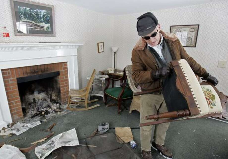 Leo Hotte of Middlebury College surveyed the damage to Robert Frost's Vermont home in December. Photo: ALDEN PELLETT, ASSOCIATED PRESS
