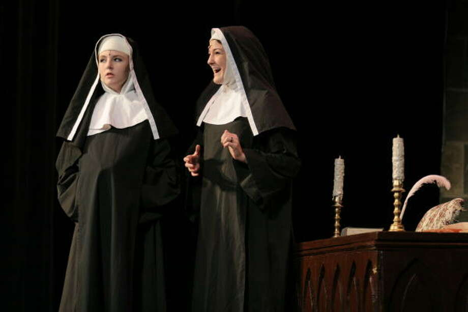 Brittany See (left) and Taylar Williams playing nuns at Katy High School's dress rehersal of The Sound of Music. Photo: Kenzie DelaTorre, For The Chronicle