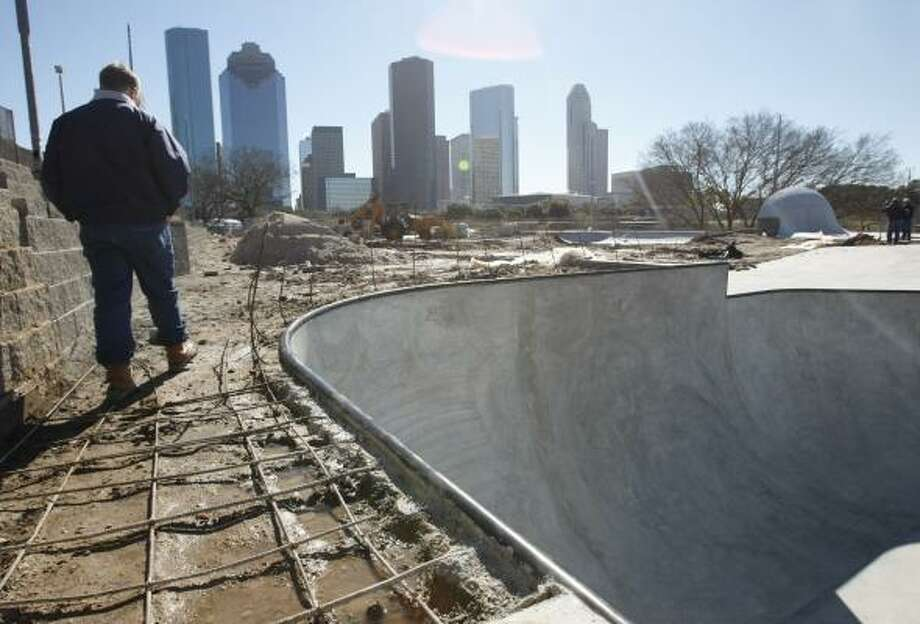Project manager Trent Rondot examines the Lee and Joe Jamail Skatepark on Wednesday. Photo: Kevin Fujii, Chronicle