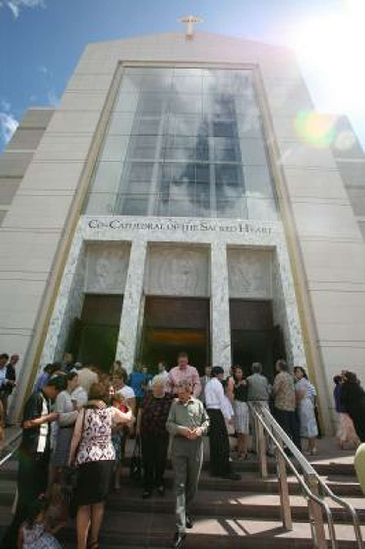 Members leave Sunday after Mass at the Co-Cathedral of the Sacred Heart. The Rev. R. Troy Gately will be departing the co-cathedral for St. John Vianney Catholic Church under the cardinal's orders.