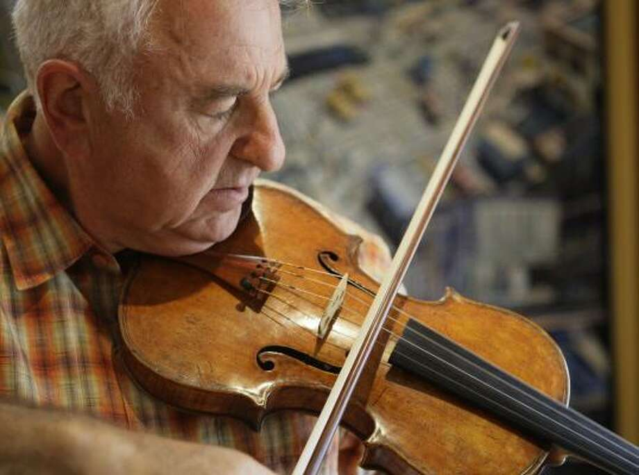 Violinist Sergiu Luca has played the violin for decades and has performed and taught in Houston and around the world. Photo: Melissa Phillip, Chronicle