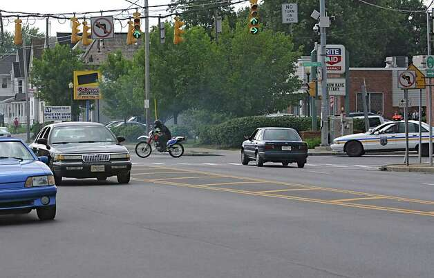 An actor on a motorcycle is chased by police during the filming for the movie ?The Place Beyone the Pines.? in Schenectady, N.Y. on Monday, Aug. 8, 2011.  (Lori Van Buren / Times Union) Photo: Lori Van Buren