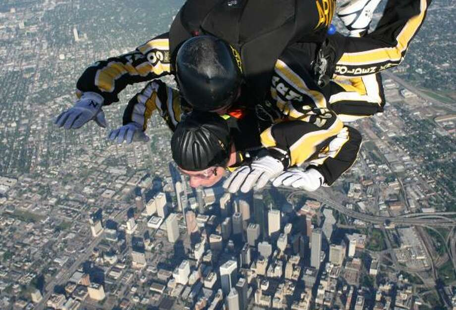 Chronicle sports writer Michael Murphy, bottom, takes in the sights during a skydive with the help of U.S. Army Staff Sgt. Joe Jones. Photo: SGT. JON EWALD, U.S. ARMY GOLDEN KNIGHTS