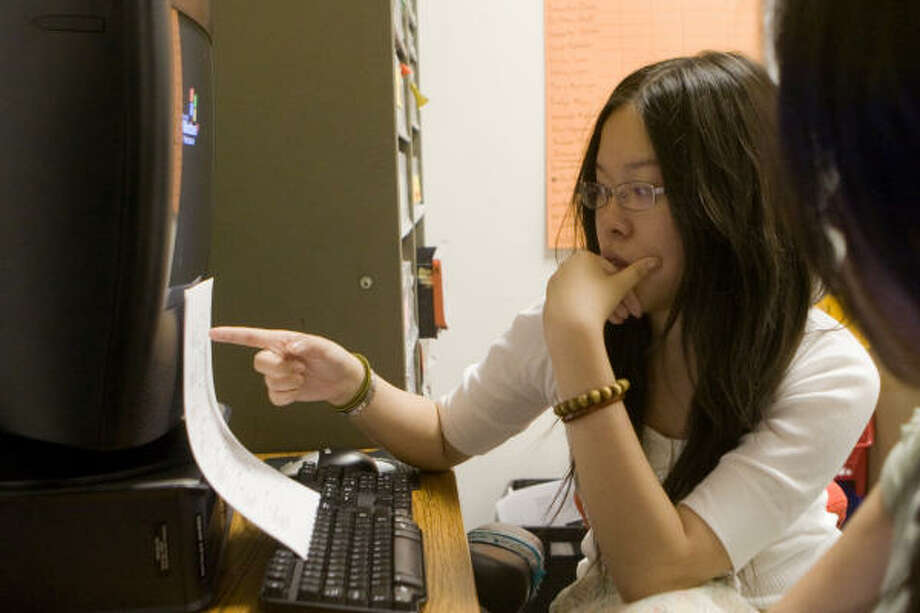 Hastings High School student newspaper Editor Tracy Chui Lau works on the next issue of the school paper. Photo: R. Clayton McKee, For The Chronicle