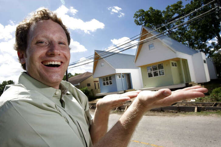 Local architect Brett Zamore stands across the street from two of his kit homes nearing completion on Center, near Thompson, in Houston's West End. Each 1,250-square-foot home has vaulted ceilings, an open kitchen and living area, and two bedrooms and baths.