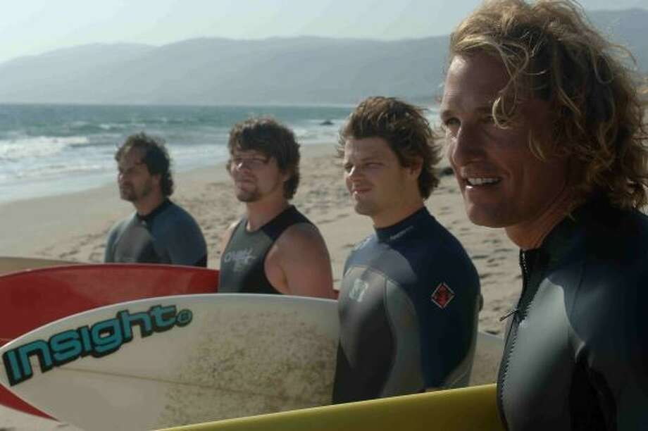 Matthew McConaughey, right, plays a surfer who returns home and finds the laid-back vibe has disappaeared in favor of a corporate-run world of surfing in Surfer, Dude.